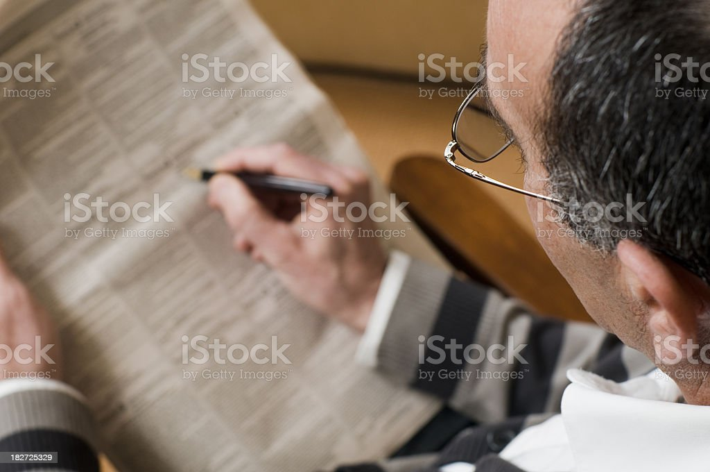 Person looking for a job on newspaper royalty-free stock photo