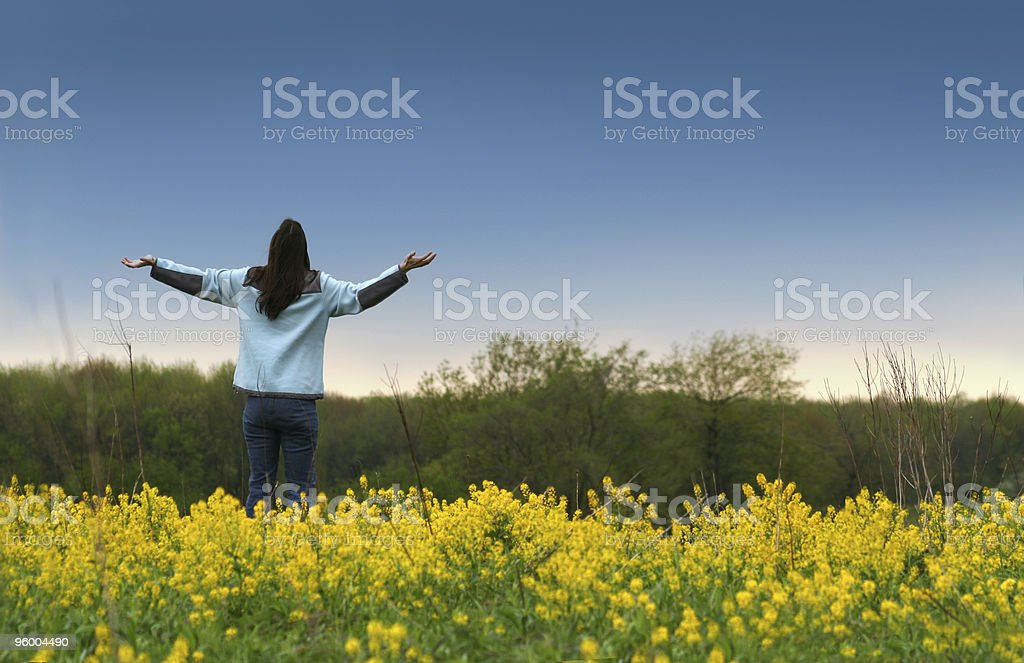 A person looking to the sky with their arms out stock photo