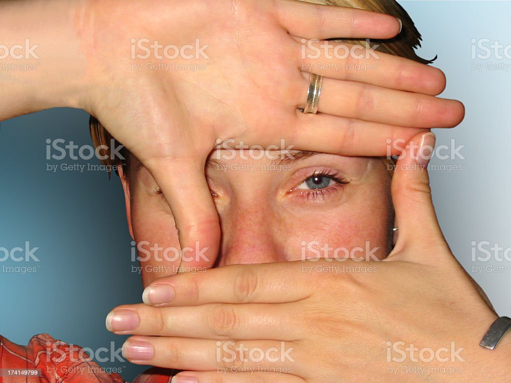 Person making a frame of their hands royalty-free stock photo