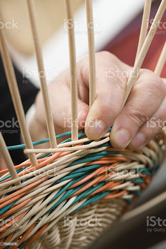 Person making basket stock photo