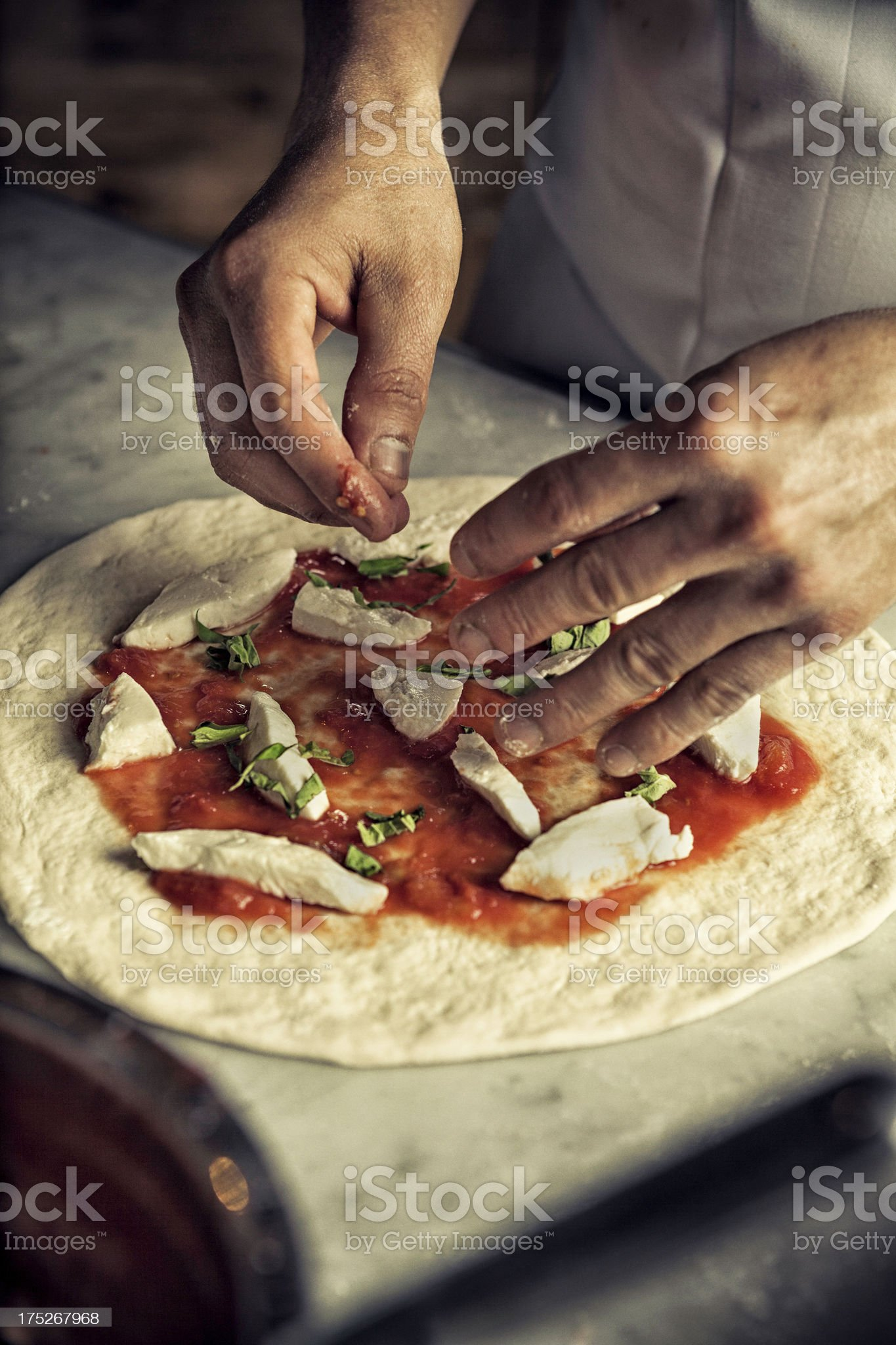 Person making mozzarella pizza royalty-free stock photo