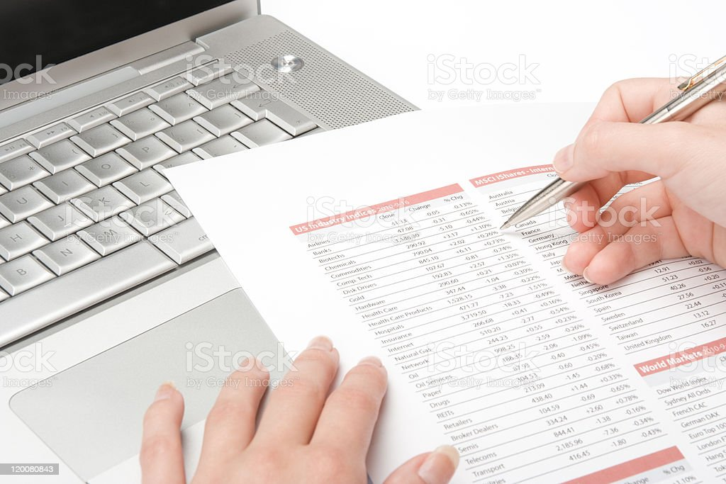 Person marking off on a business analyst stock photo