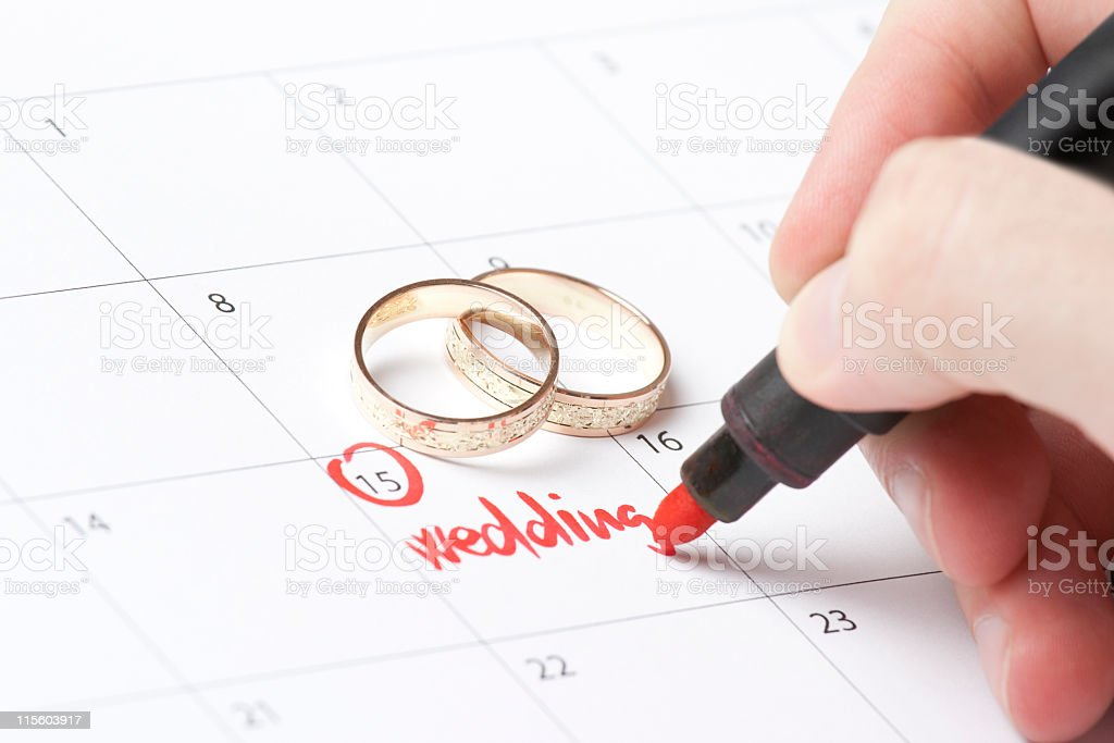 A person marking off their wedding date in the calendar royalty-free stock photo