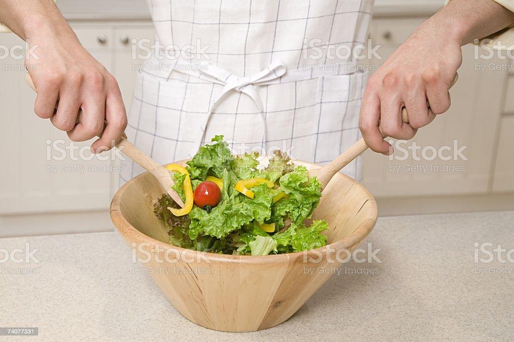Person mixing salad stock photo