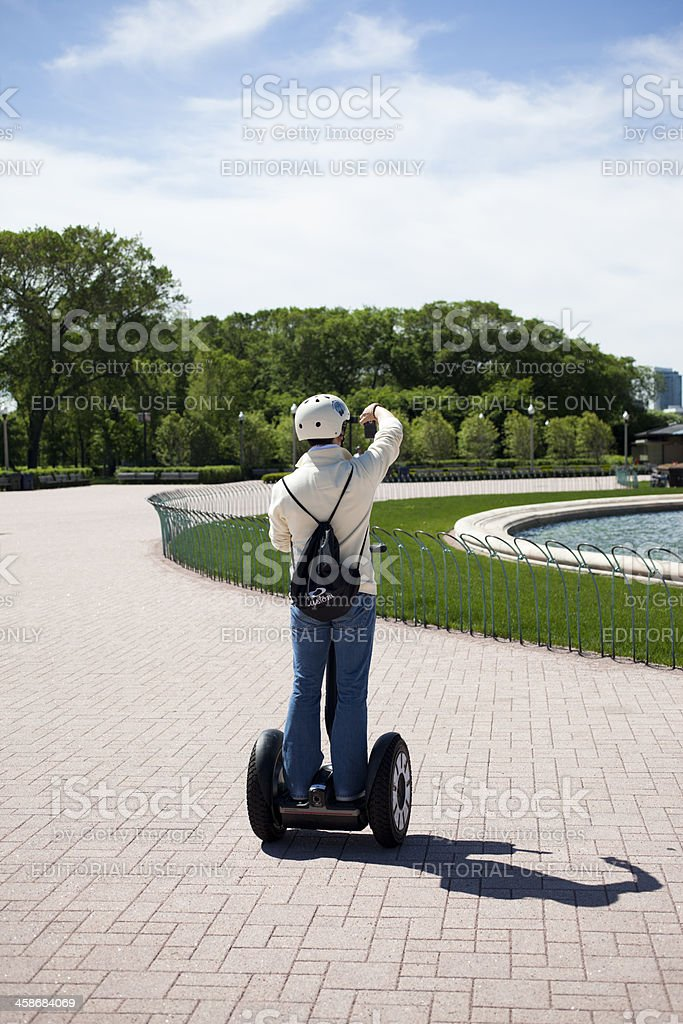 Person on a Segway Taking Pictures in Grant Park Chicago royalty-free stock photo