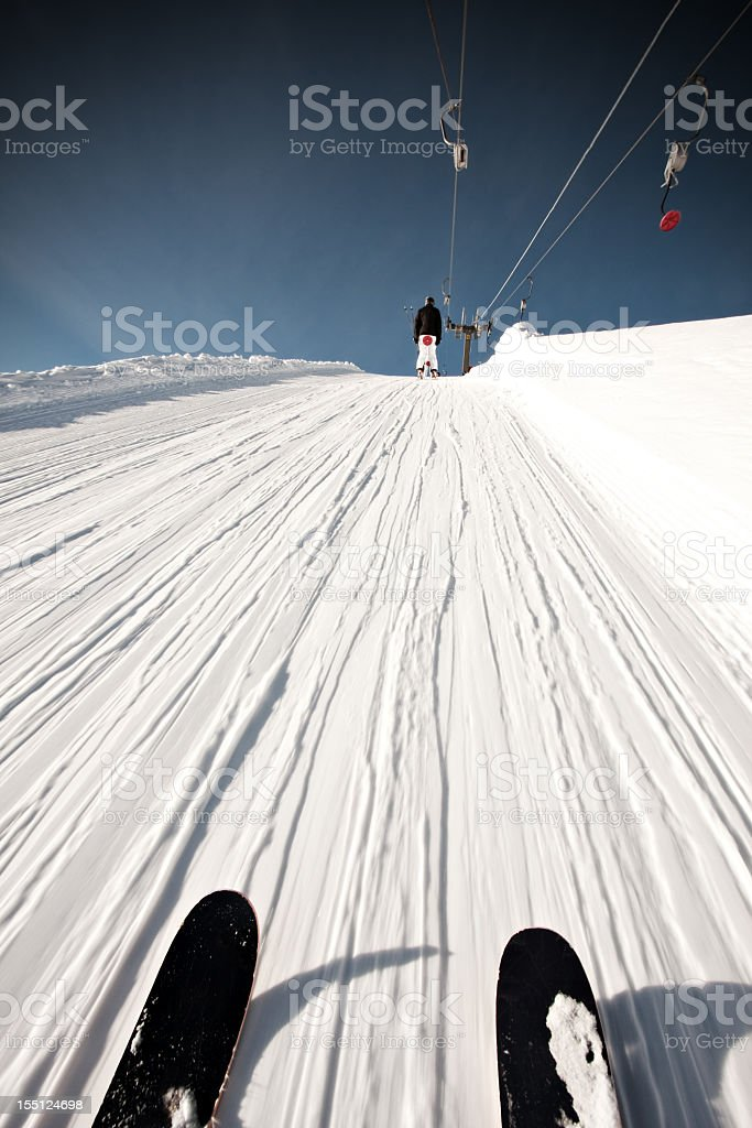 Person on a ski lift in the mountains royalty-free stock photo
