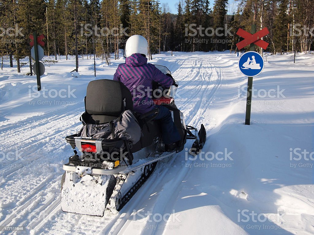 Person on a snow scooter royalty-free stock photo