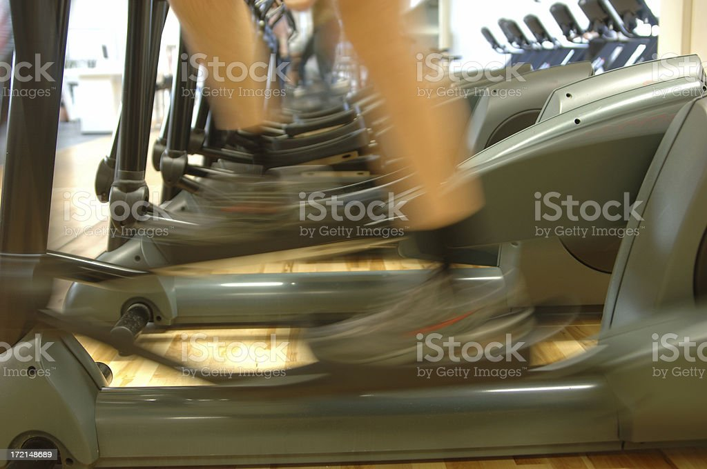 person on a stairmaster stock photo