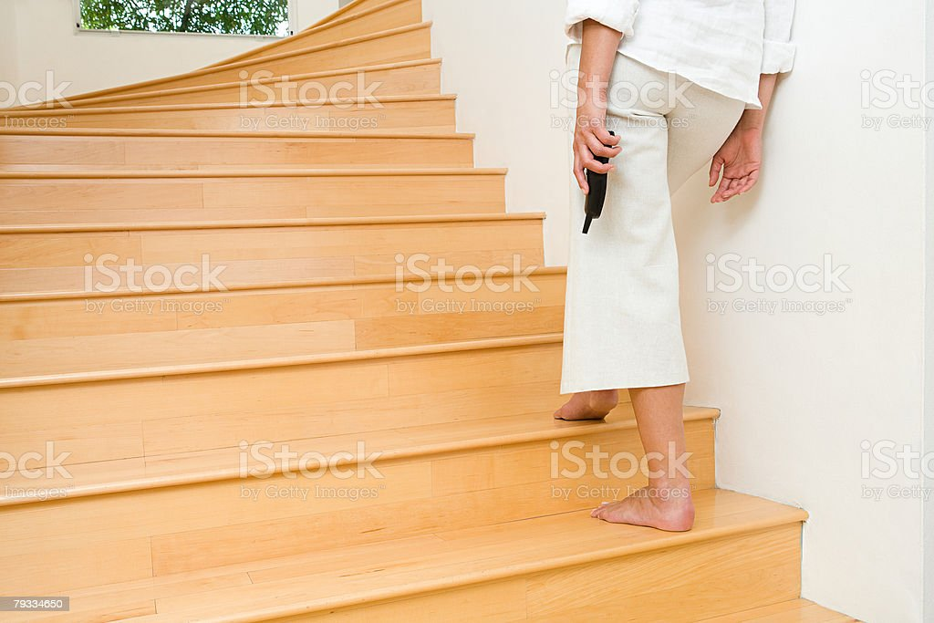 Person on stairs stock photo