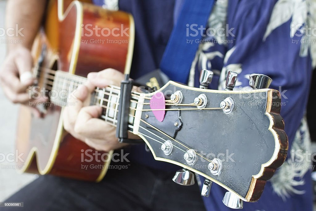 Person Playing a Guitar stock photo