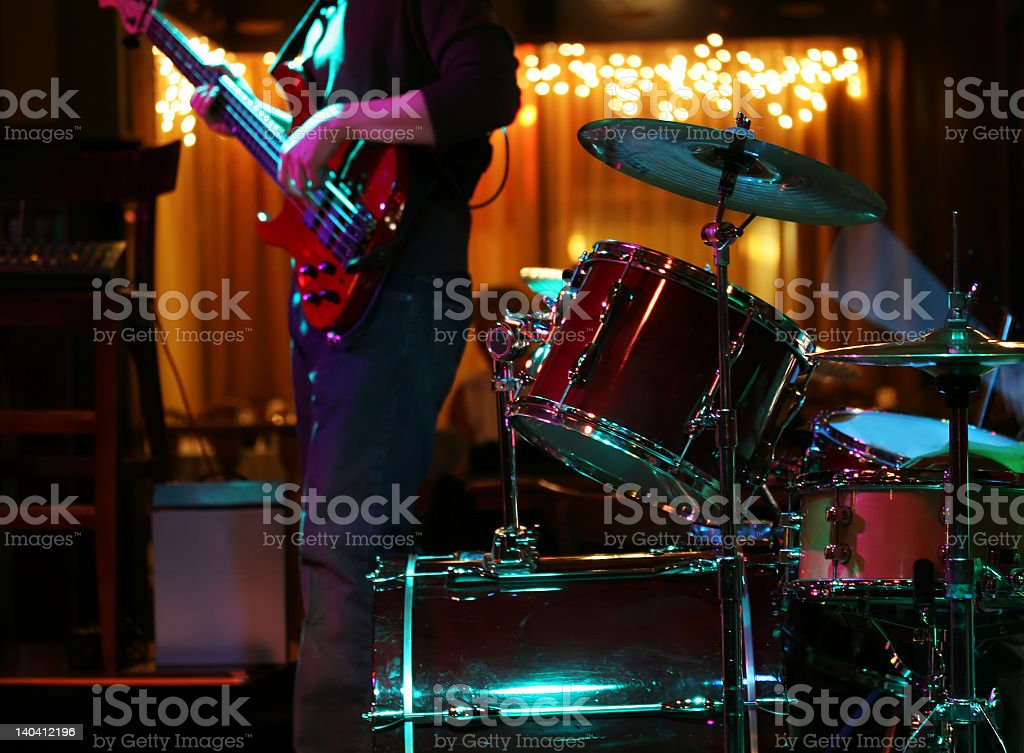 Person playing a red electric guitar at a rock show stock photo