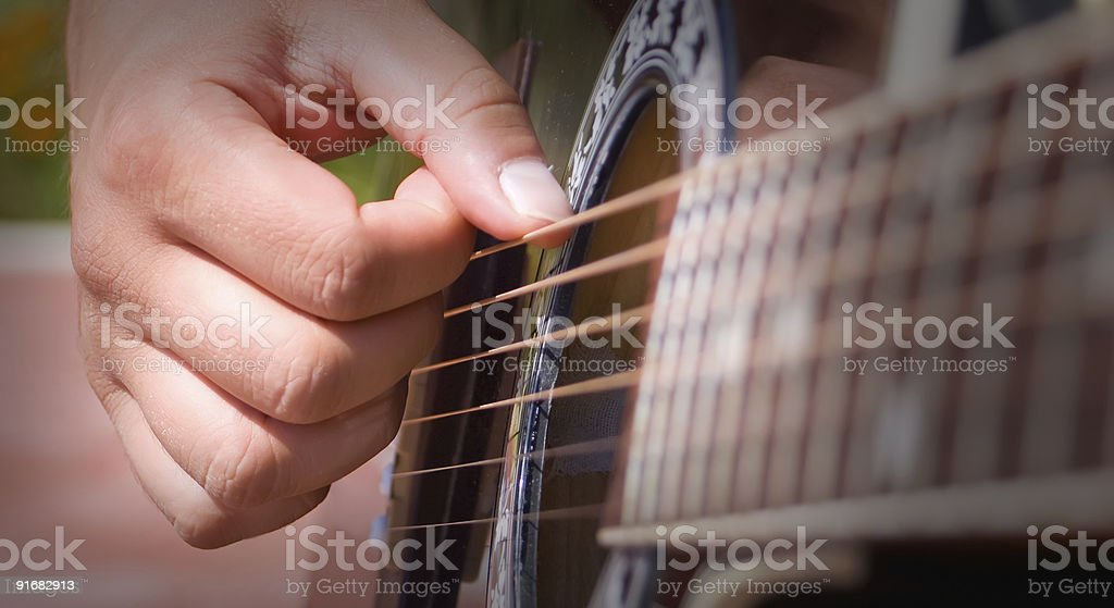Person playing acoustic guitar royalty-free stock photo