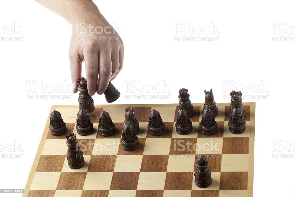 person playing chess game stock photo