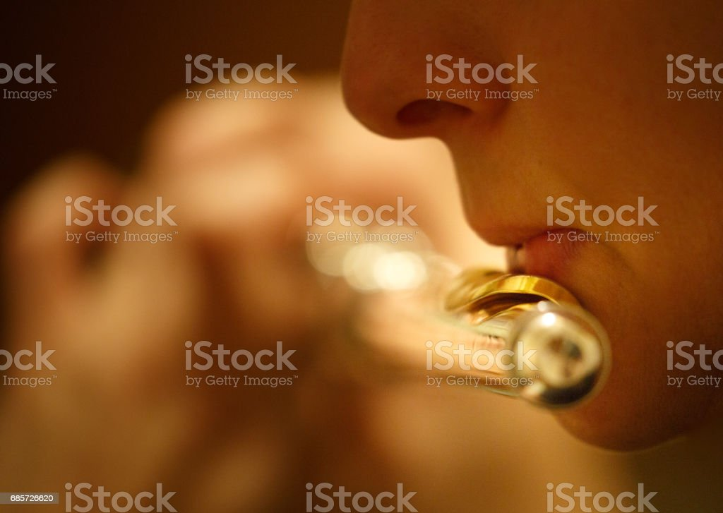 Person playing flute stock photo