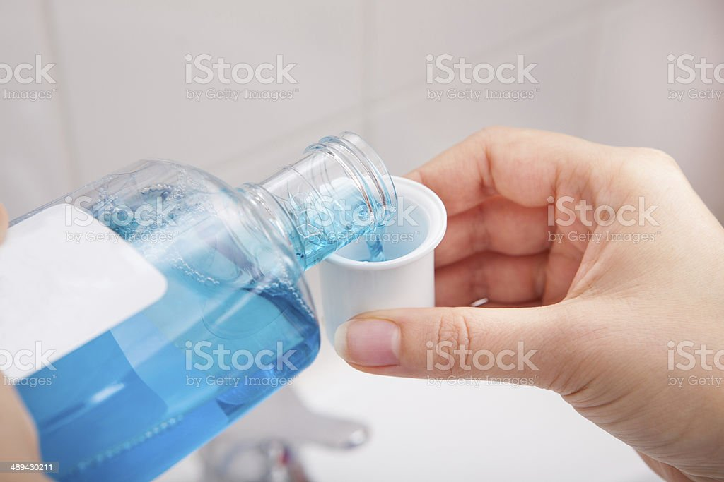 Person Pouring Liquid In Container stock photo