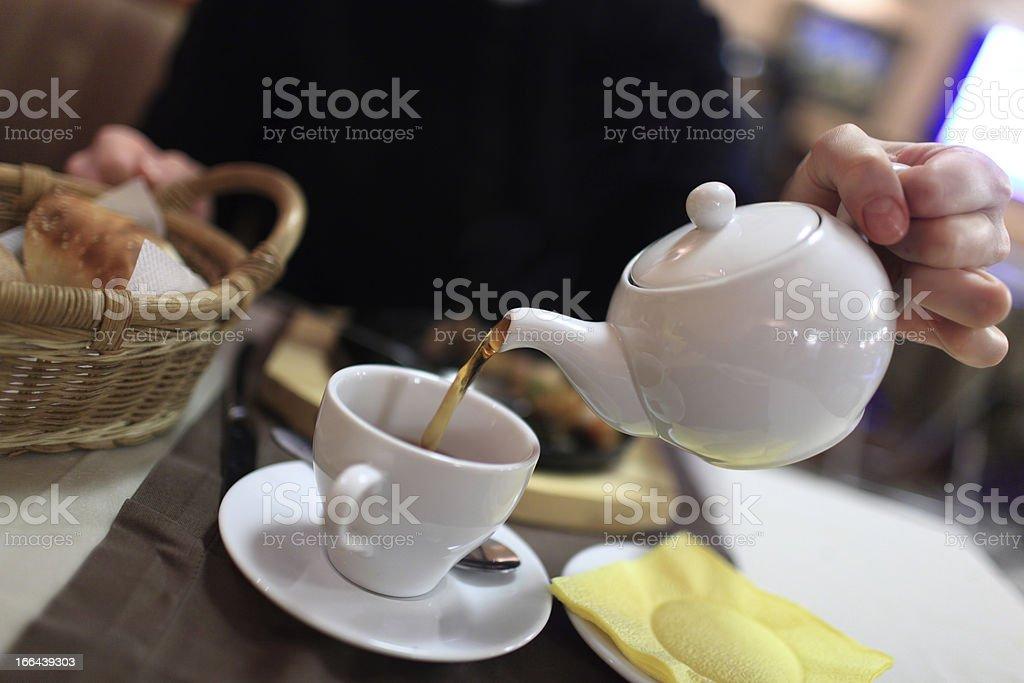Person pouring tea stock photo