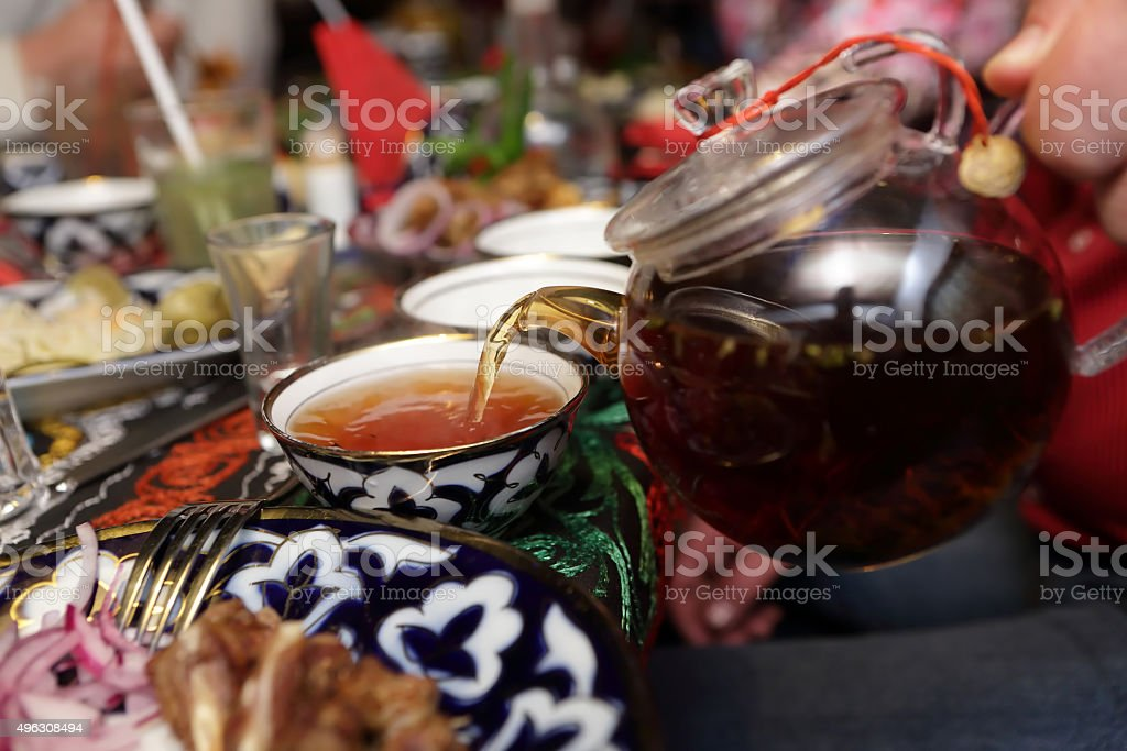 Person pouring tea stock photo
