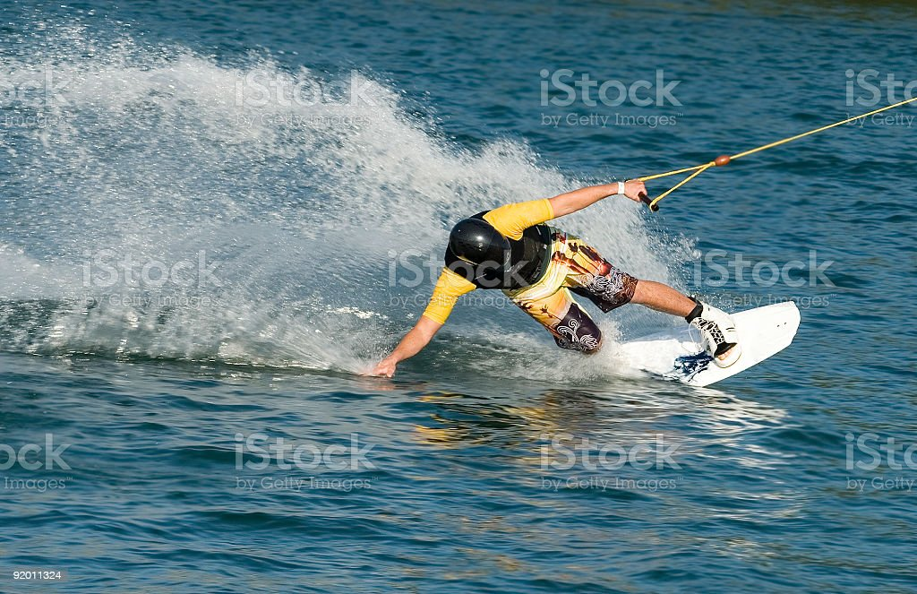 A person practicing water boarding stock photo