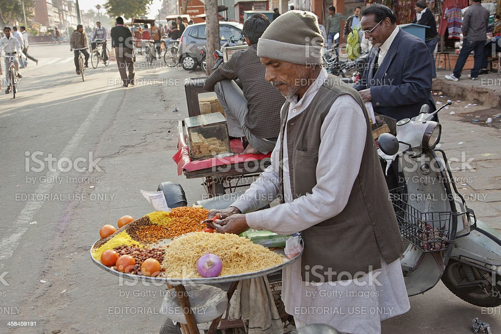 person preparing fast food at street of jaipur india royalty-free stock photo
