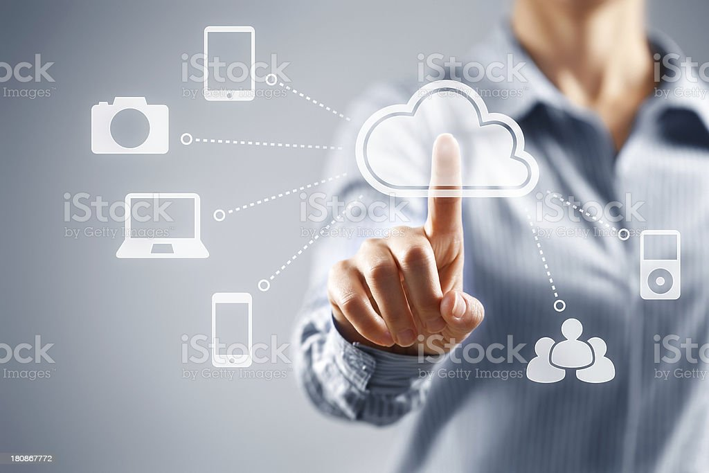 Person presses hologram of cloud computing icons stock photo