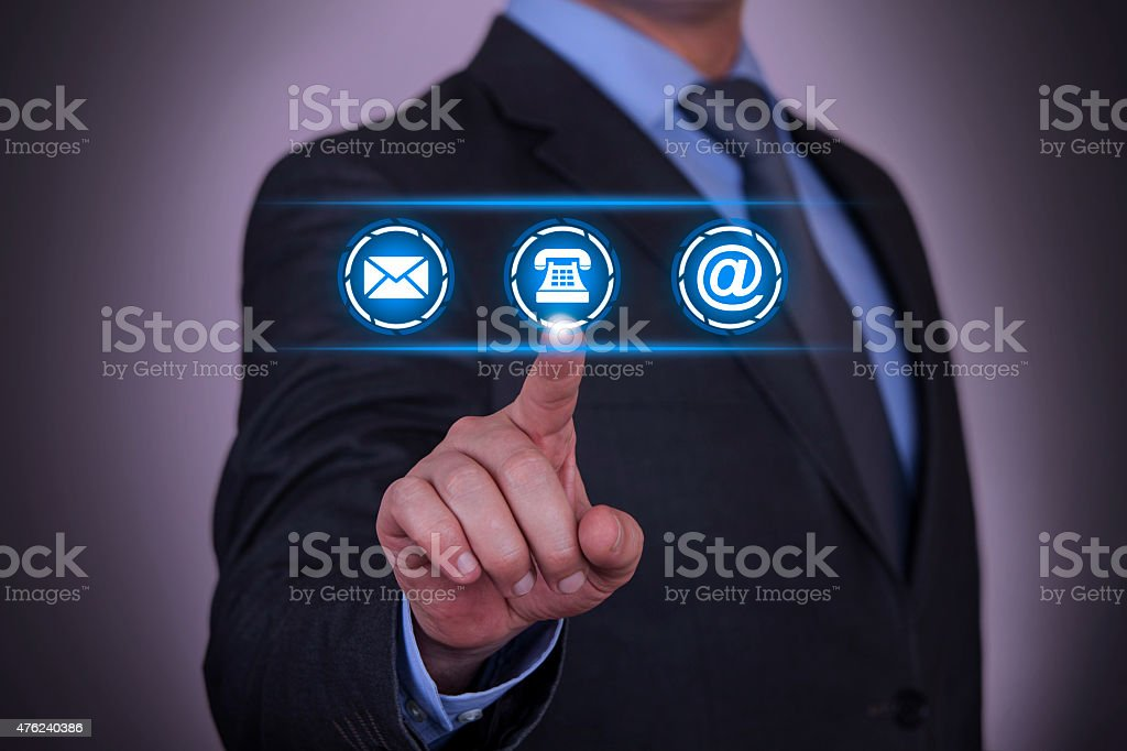 Person presses hologram of contact us icons stock photo