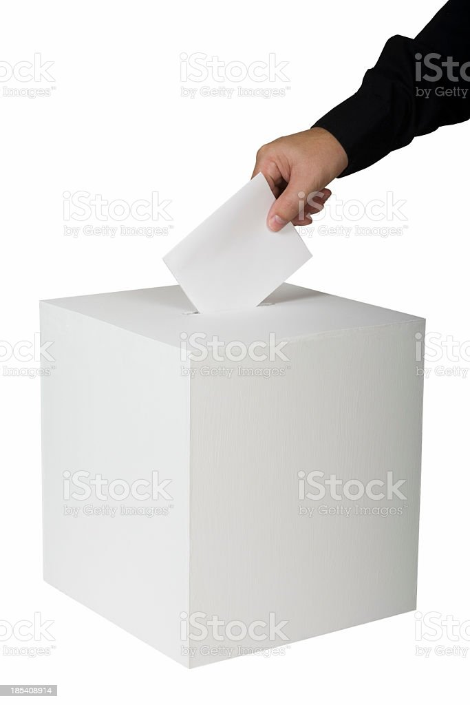 A person putting a vote in a ballot box stock photo