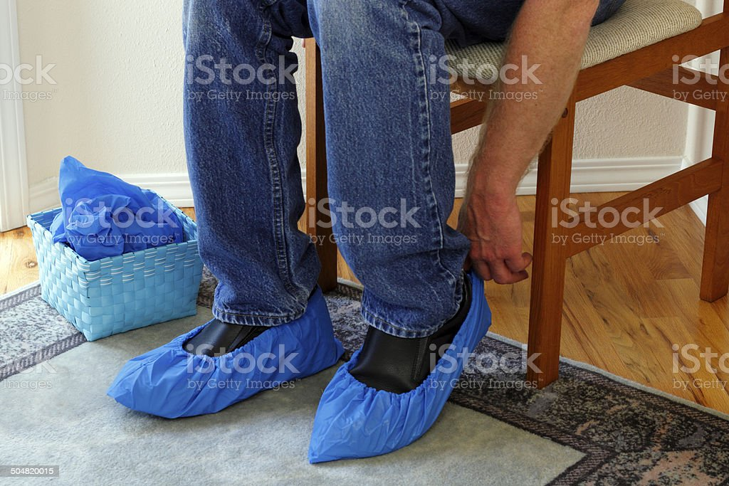 Person Putting on Booties stock photo