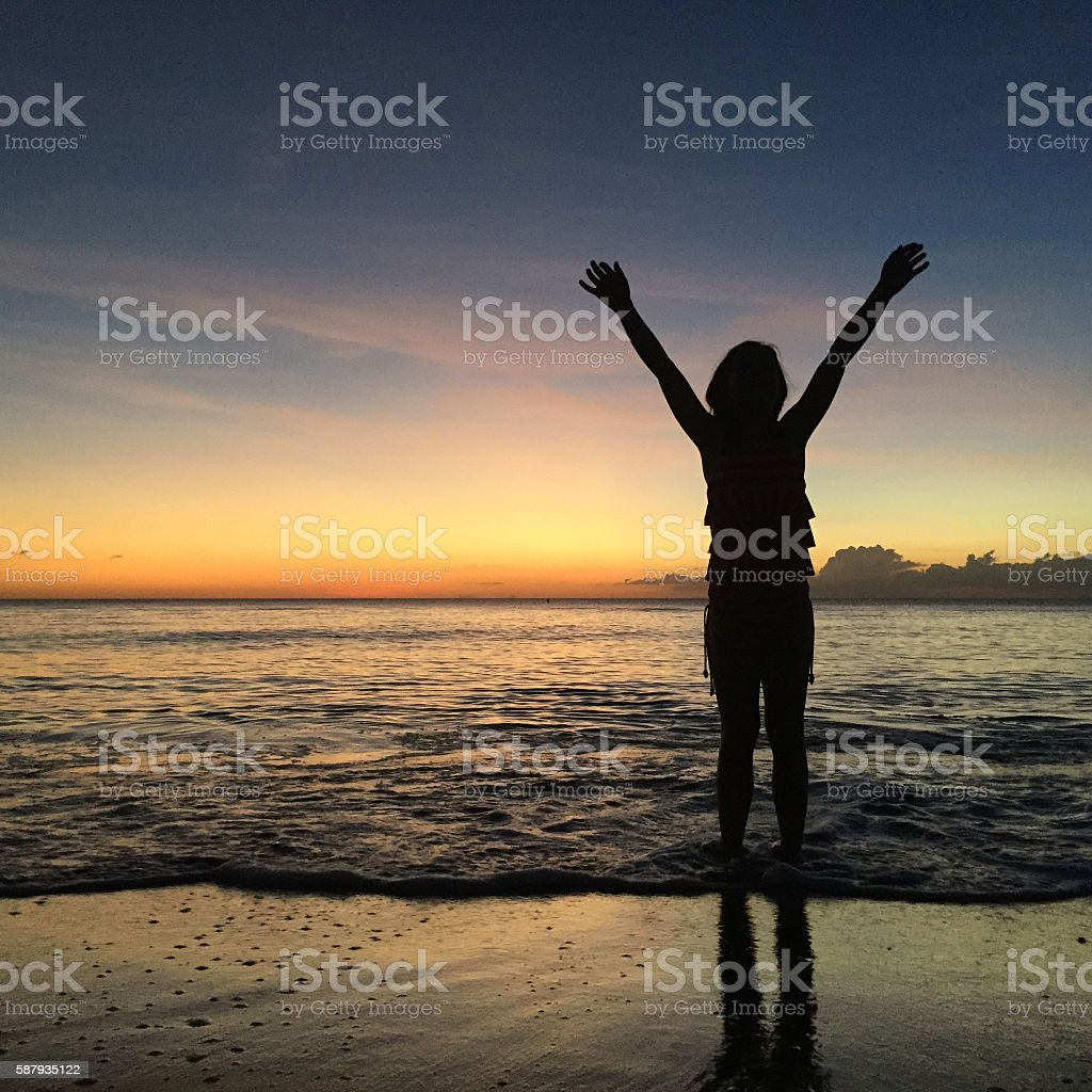 Person Raising Hands in Praise and Worship to God stock photo