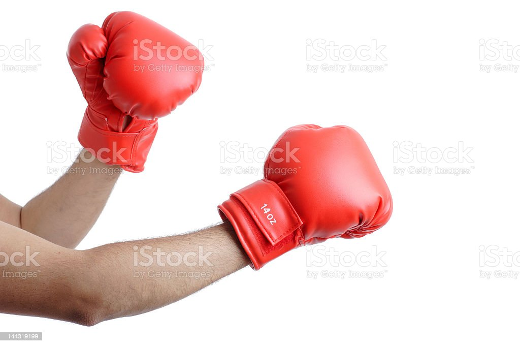 A person raising their red boxing gloves ready to fight stock photo