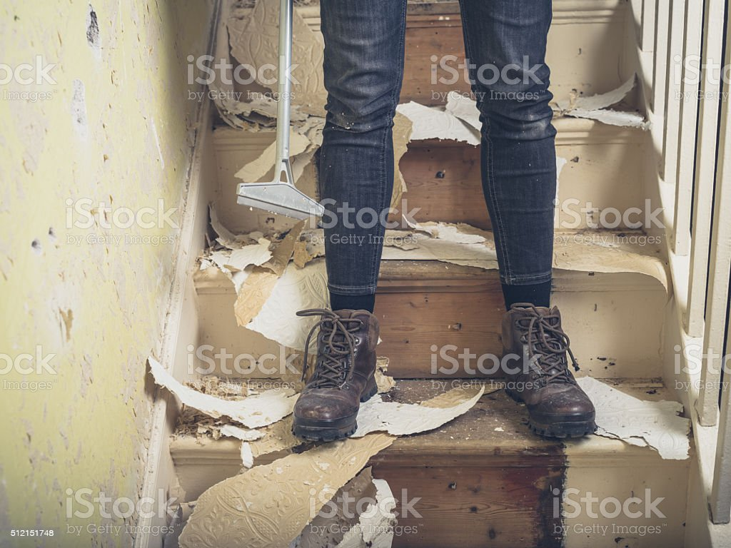 Person renovating on stairs stock photo