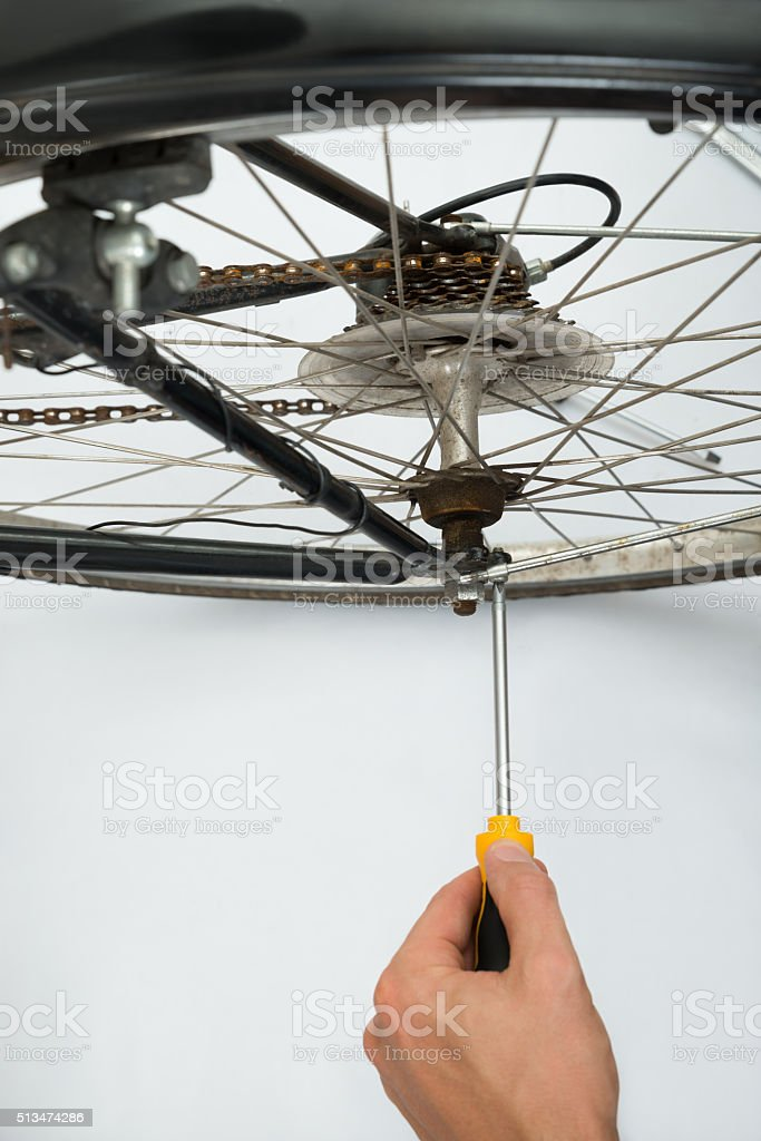 Person Repairing Bicycle Wheel stock photo