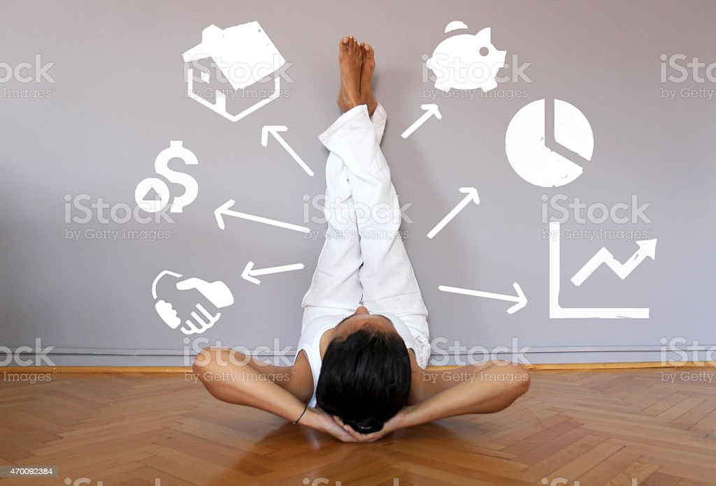 Person resting legs against a wall with idea illustrations stock photo