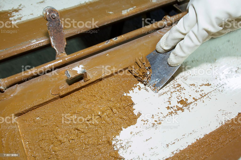 A person restoring a brown piece of material royalty-free stock photo
