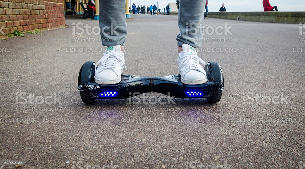 Person Riding a HoverBoard on a Public Footpath stock photo