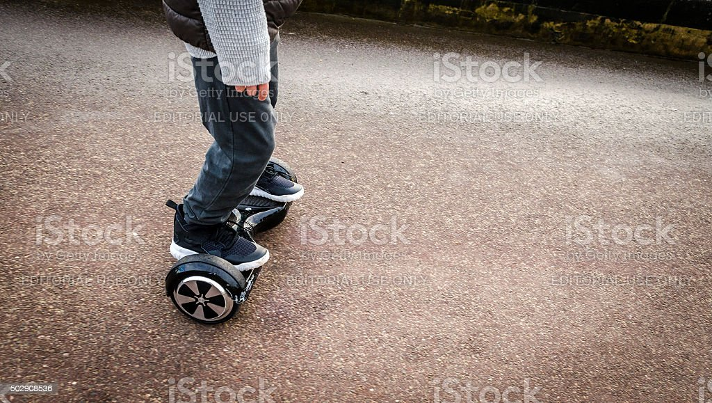 Person Riding a HoverBoard on a Public Footpath, stock photo