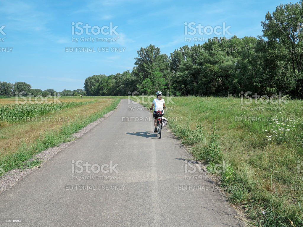 Person riding bcycle  near river rhein at speyer germany stock photo