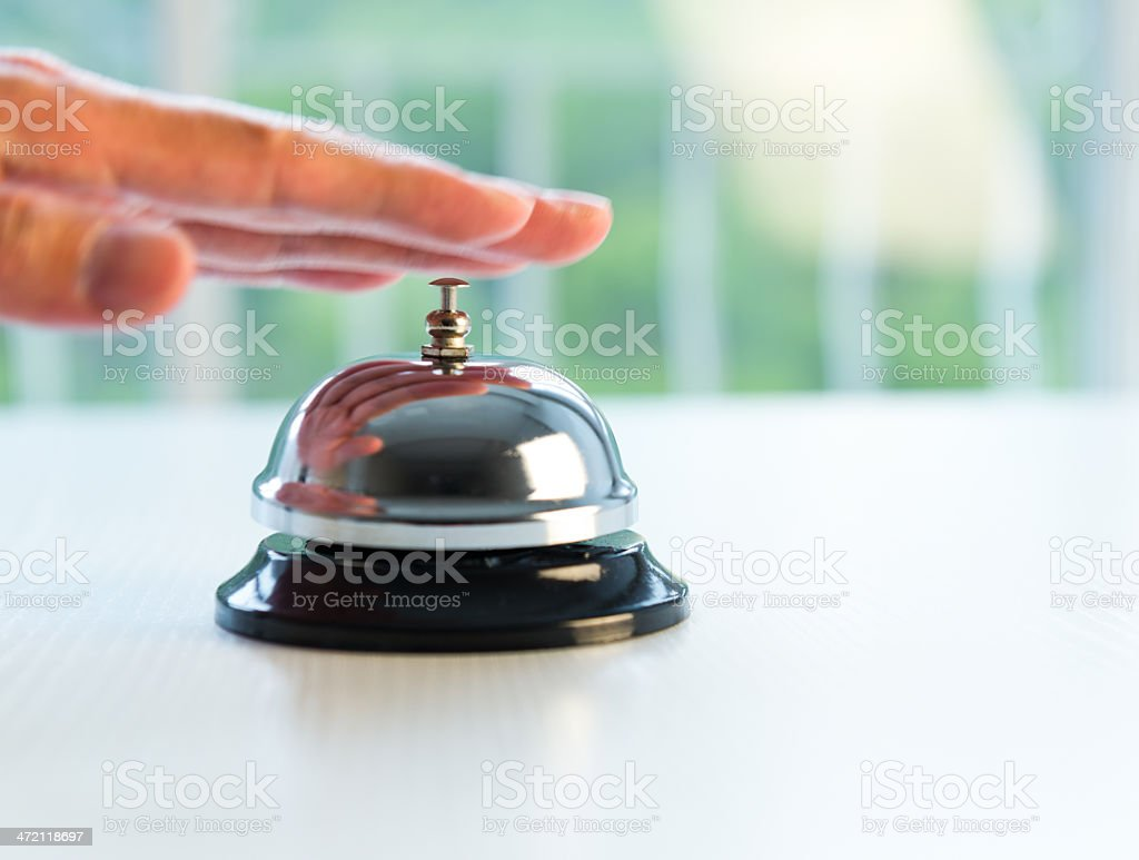 Person ringing bell for service stock photo