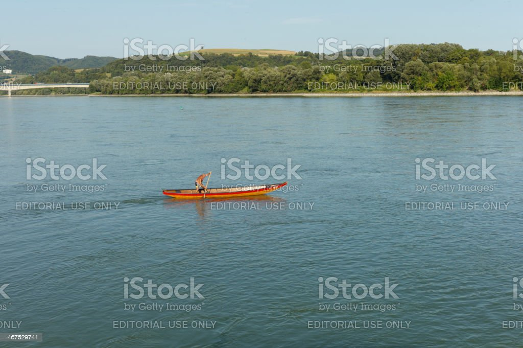 person rowing at danube river in austria stock photo