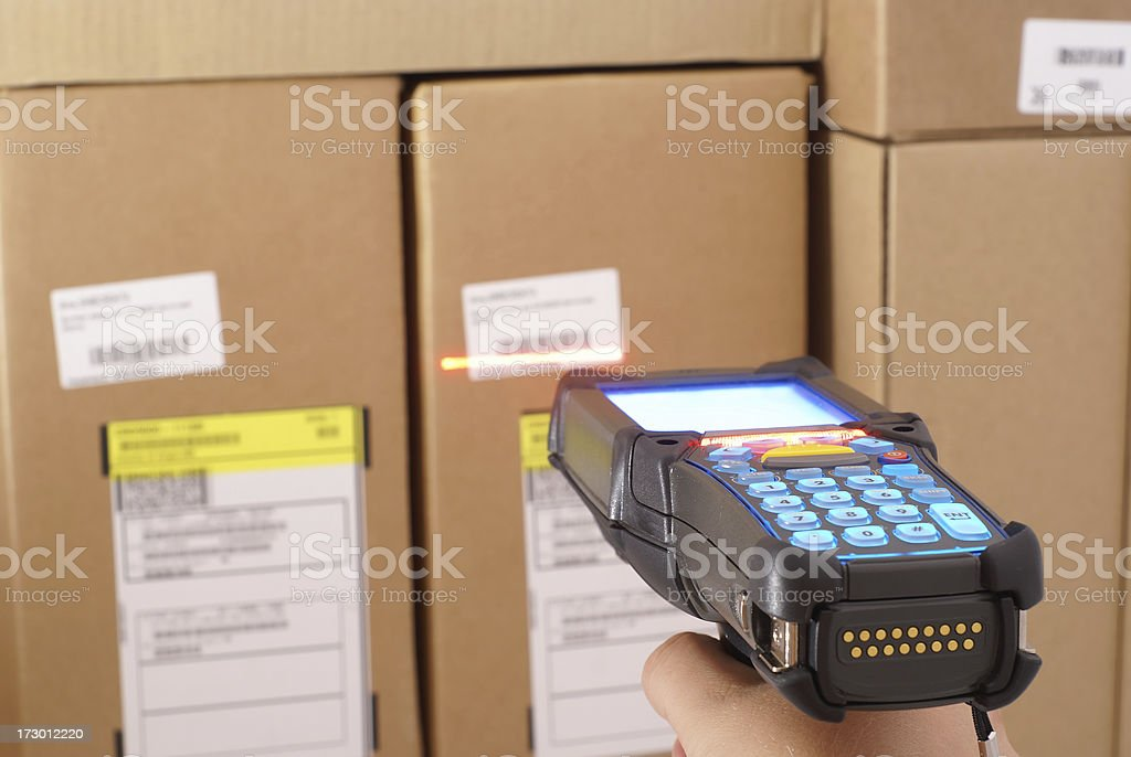Person scanning bar codes in a warehouse royalty-free stock photo