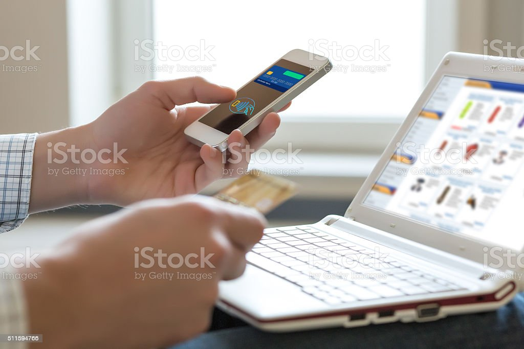 Person shopping making Mobile Payment with Telephone stock photo