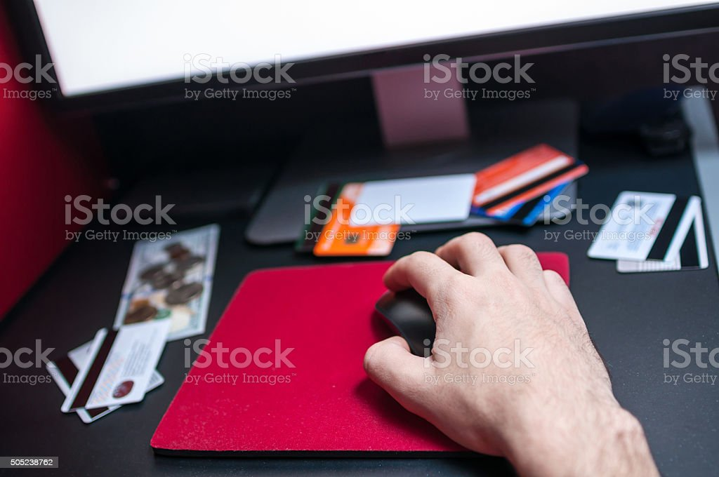 Person shopping online using computer and credit card stock photo