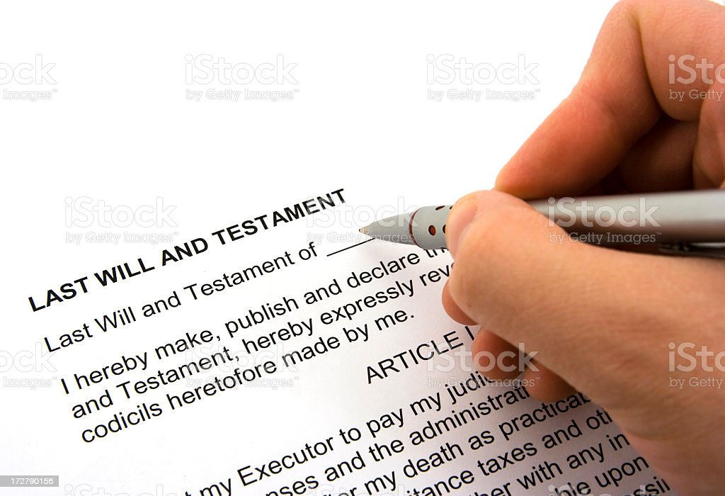 Person Signing a Will and Testament Form royalty-free stock photo