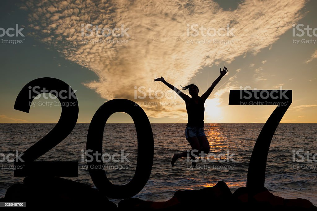 Person silhouette jumping in New Year 2017 stock photo