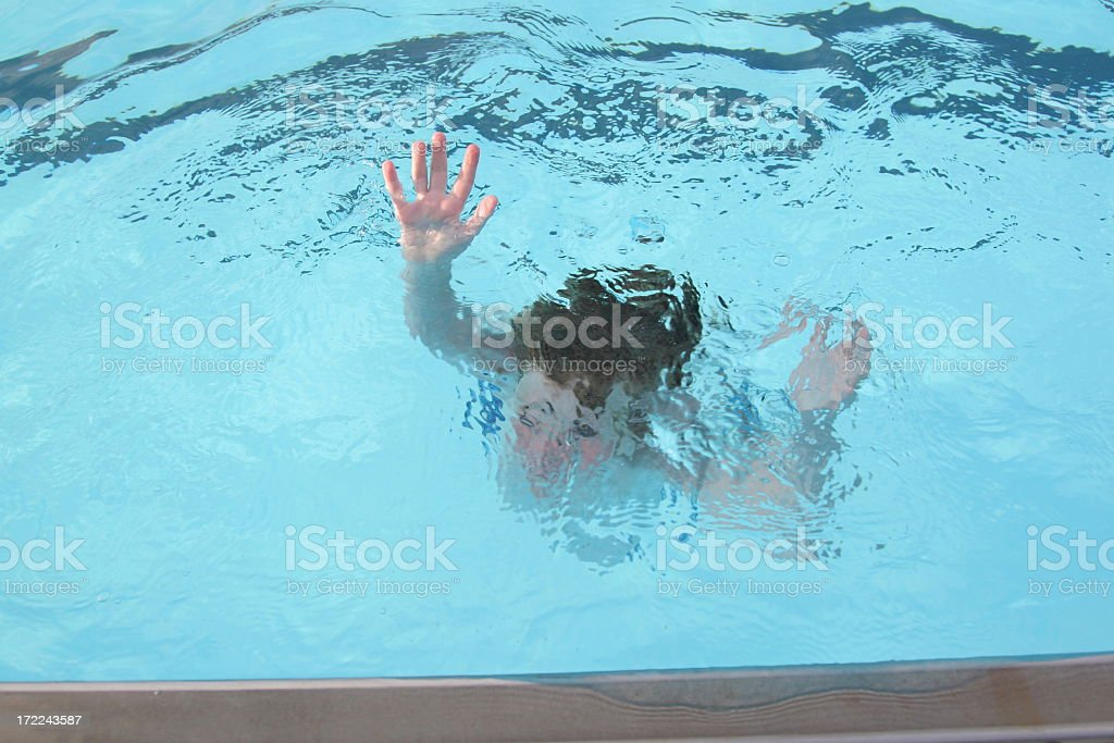 A person sinking in a swimming pool  stock photo