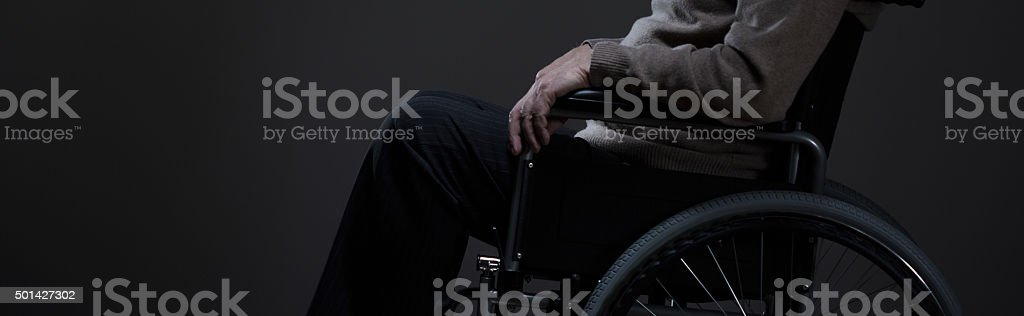 Person sitting on a wheelchair stock photo