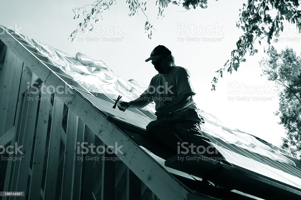 A person sitting roof in black and white stock photo