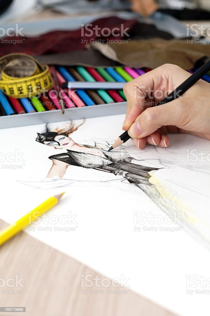 Person sketching fashion design stock photo