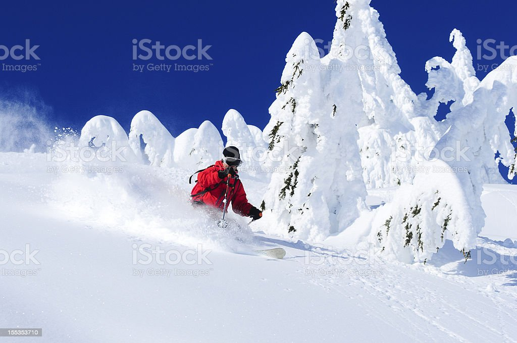 A person skiing down an icy slope stock photo