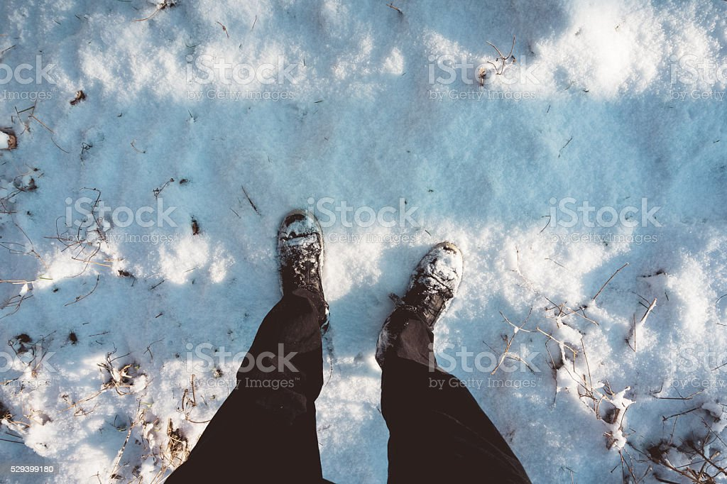 Person standing in winter snow stock photo