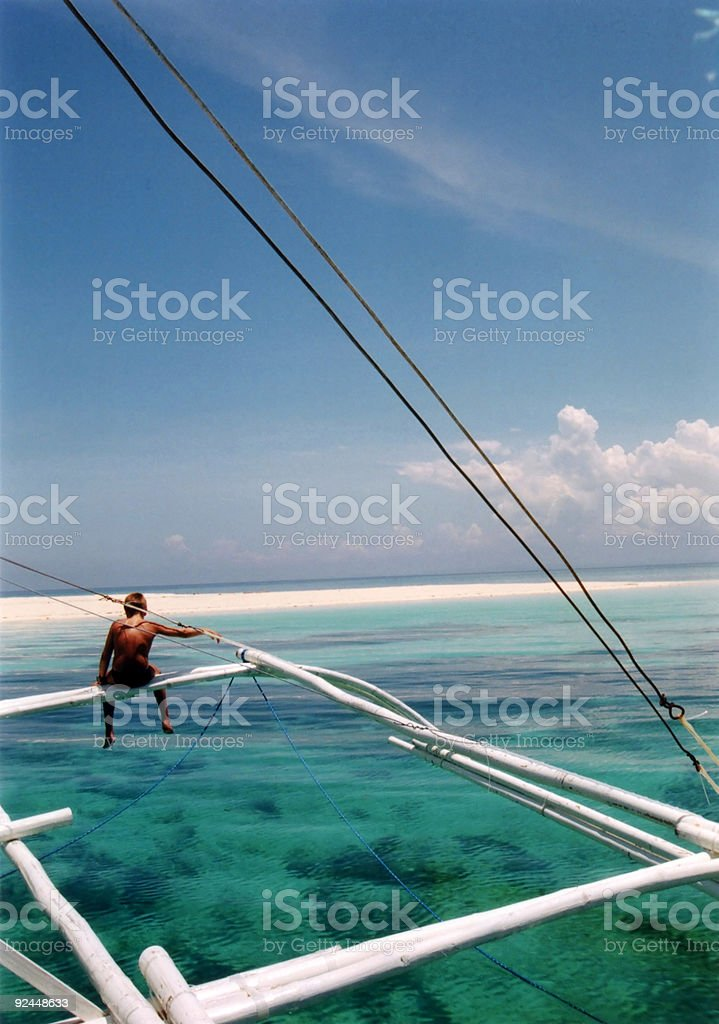 A person standing on a clear surface over water royalty-free stock photo